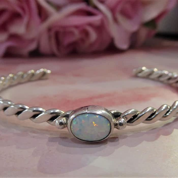 silver and opal torque bangle