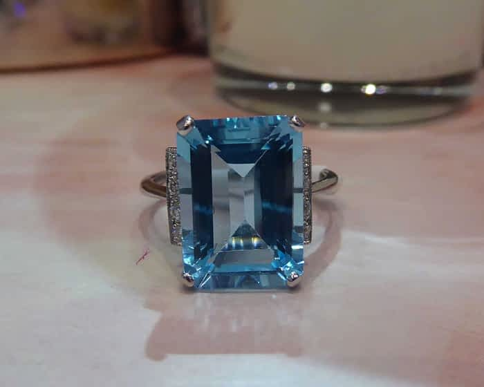 9ct white gold, blue topaz and diamond art deco style ring