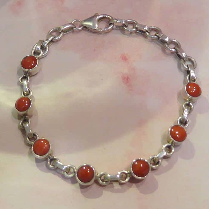 silver and coral link bracelet