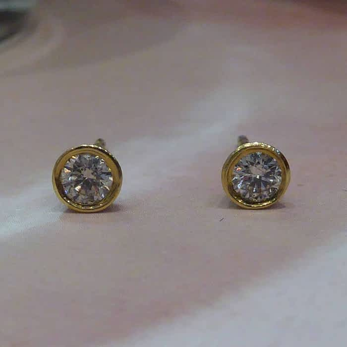 18ct yellow gold rub over diamond studs approx 0.27ct