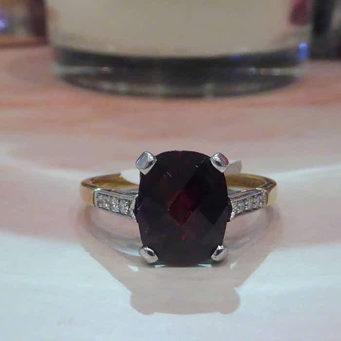 9ct gold, diamond and cushion cut garnet ring