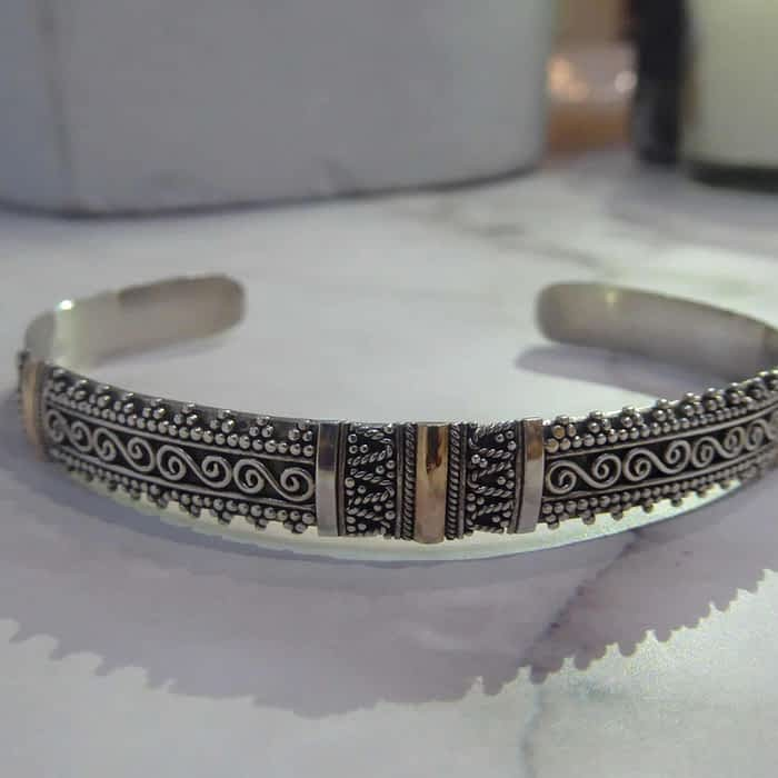 silver and 18ct gold torque bangle