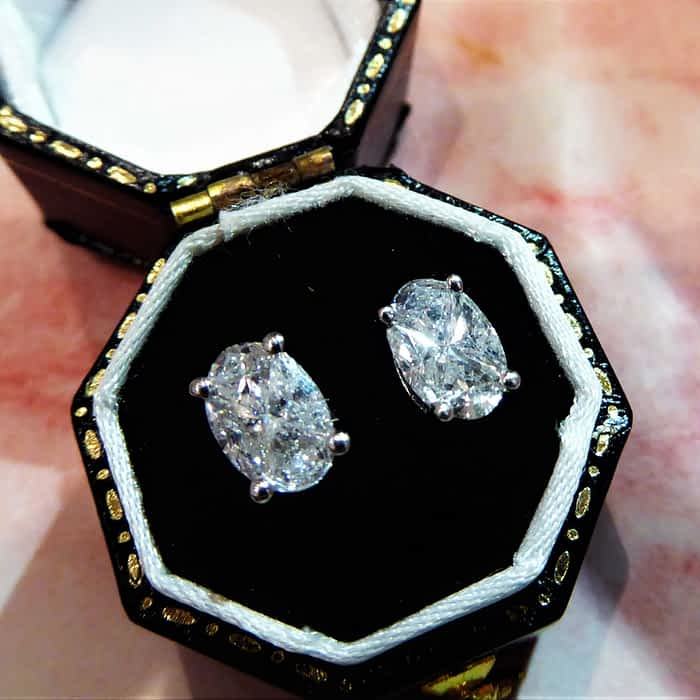 18ct white gold oval diamond studs 1.45ct in total.