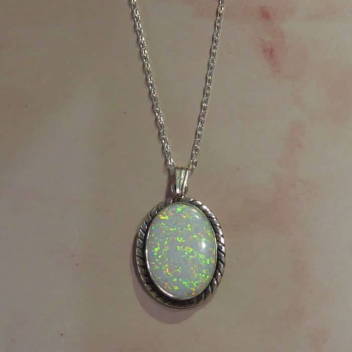 silver and oval opal pendant and chain