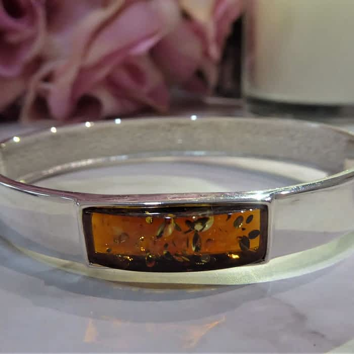 silver and amber modern bangle